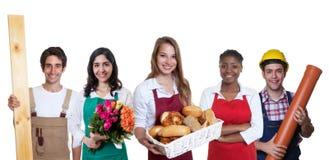 有小组的美丽的白种人女性面包师其他国际性组织 免版税库存照片