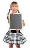 有小黑板的小女孩 免版税库存照片
