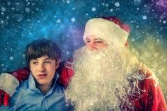 有少年的地道圣诞老人 图库摄影