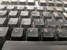 有尘土的键盘 库存图片