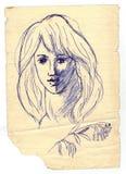 有山脉灰小树枝的金发碧眼的女人  库存照片