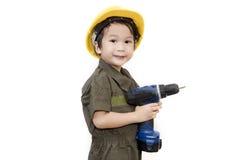 有工具板钳的技工男孩在被隔绝的白色背景 免版税图库摄影