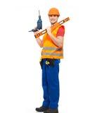 有工具的微笑的工作员在制服 免版税库存图片