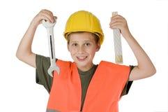 有工具的男孩在白色 免版税库存图片