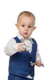 有工具的男孩在白色 免版税图库摄影