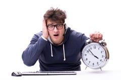有巨型时钟的滑稽的书呆子电话中心操作员 库存照片