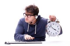 有巨型时钟的滑稽的书呆子电话中心操作员 免版税库存图片
