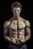 有巨大身体的运动员 免版税库存照片
