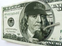有帽子和气泵的本Fanklin在一百元钞票 库存图片