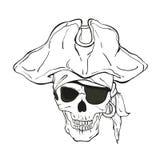有帽子和眼睛补丁的海盗头骨 库存图片