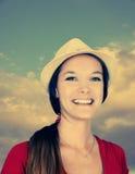 有帽子定调子的少妇 免版税库存照片