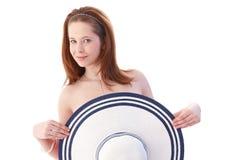 有帽子微笑的性感的妇女 库存照片