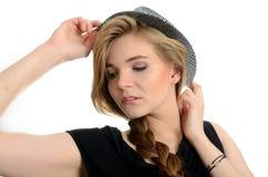有帽子的女孩 免版税库存图片