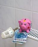有幅射器温箱挽救加热成本的存钱罐 图库摄影