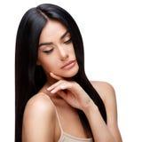 有干净的健康头发的美丽的少妇 免版税库存图片