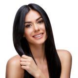 有干净的健康头发的美丽的少妇 图库摄影