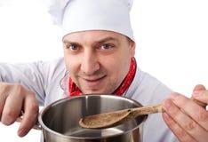 有平底锅的厨师 库存照片
