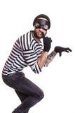 有平静地潜逃的面具的一位窃贼 图库摄影