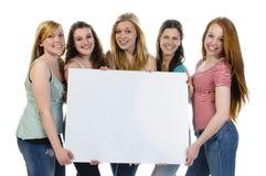 有广告牌的女孩 免版税库存照片