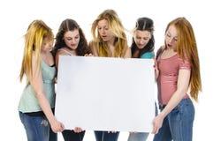 有广告牌的女孩 免版税库存图片