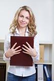 有应用投资组合的妇女 免版税库存照片