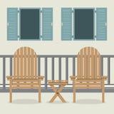 有庭院椅子和开放Windows的议院露台 免版税库存图片
