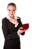 有开放光盘盒的被敬佩的女商人 免版税库存照片