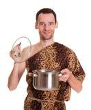 有开放炖煮的食物平底锅的愉快的微笑的极端分子 免版税图库摄影