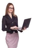 有开放膝上型计算机的女实业家在白色背景 库存照片