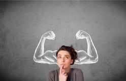有强的肌肉的胳膊的少妇 库存照片