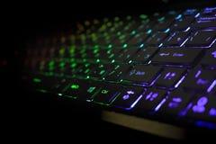 有彩虹光的键盘 免版税库存图片