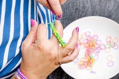 有彩虹织布机的妇女 库存照片