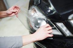 有影片的保护的汽车汽车前灯 库存照片
