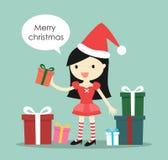 有很多礼物盒和说的'圣诞快乐'圣诞老人女孩 免版税库存照片