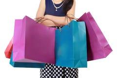 有很多购物袋的美丽的妇女 免版税库存照片