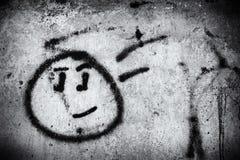 有微笑面孔的街道画墙壁 免版税库存照片