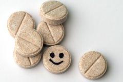 有微笑面孔的配药片剂 免版税库存图片