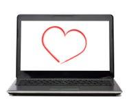 有心脏的便携式计算机在白色屏幕上 库存照片