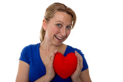 有心脏的女性在她的手上 库存图片
