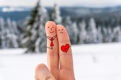 有心脏的愉快的两个手指 免版税库存照片