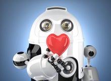 有心脏的机器人在手中 概念查出的技术白色 包含裁减路线 库存照片