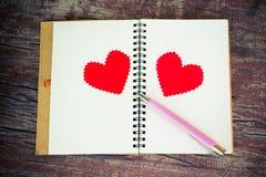 有心脏的笔记本 免版税库存图片
