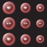 有心脏的红色按钮在黑背景 免版税库存照片