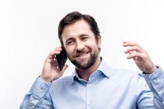 有快乐的人一次活泼的电话交谈 免版税库存照片