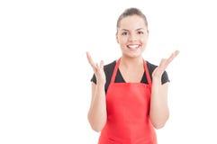 有快乐的大型超级市场的雇员揭示 免版税库存图片