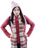 有恼怒的面孔佩带的毛线衣的俏丽的女孩 免版税图库摄影