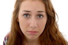 有悲伤表示的美丽的少妇  免版税图库摄影