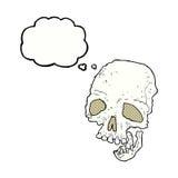 有想法泡影的动画片古老鬼的头骨 图库摄影