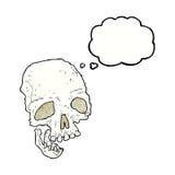 有想法泡影的动画片古老鬼的头骨 免版税图库摄影