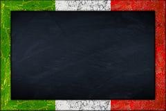 有意大利旗子框架的黑板 库存图片